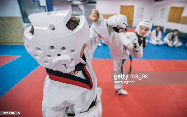 cute kids on taekwondo class - artes marciais imagens e fotografias de stock