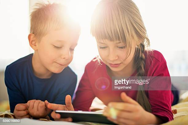 Cute kids using digital tablet