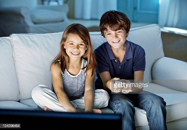 Cute kids watching television