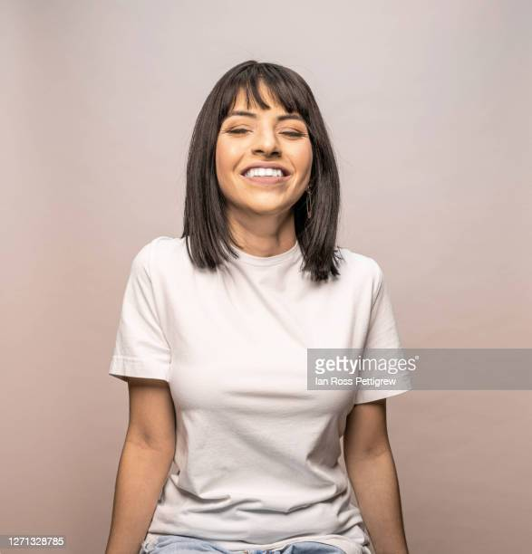 cute latina woman in white t-shirt - white shirt stock pictures, royalty-free photos & images