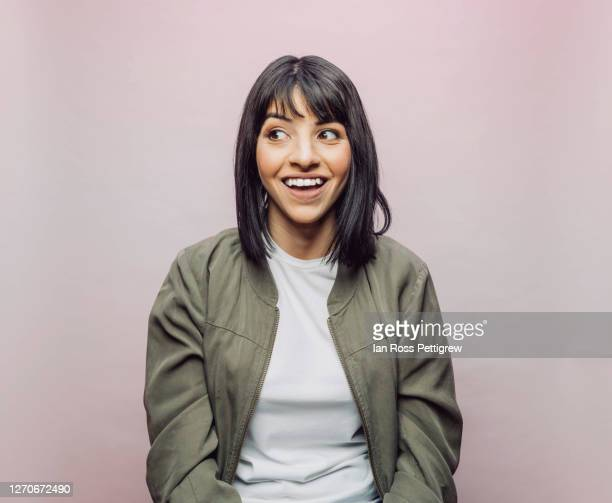 cute latina woman looking surprised - surprise stock pictures, royalty-free photos & images