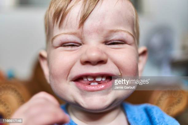 cute little baby boy laughing - innocence stock pictures, royalty-free photos & images