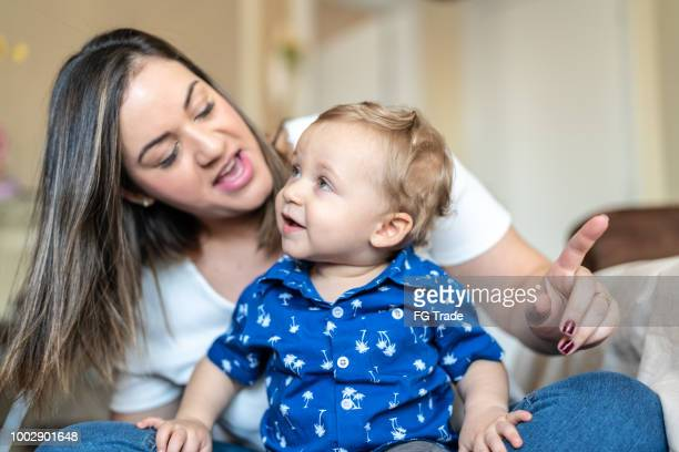 Cute Little Baby Enjoying the Day with Your Mother at Home