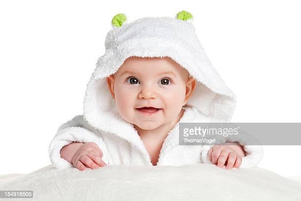 Cute little baby in bathrobe