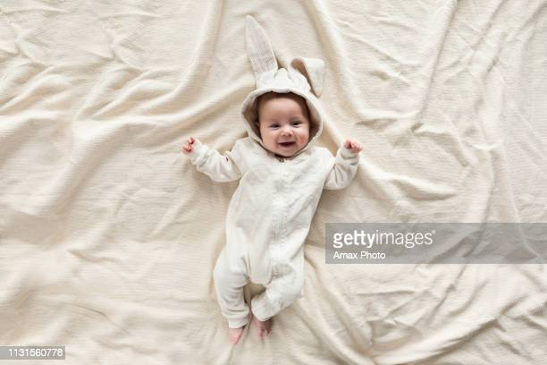 cute little baby in bunny costume on blanket at home, top view - cute babies stock pictures, royalty-free photos & images