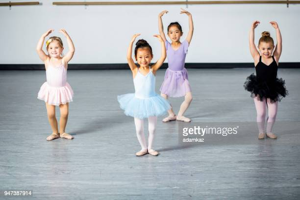 cute little ballerinas practicing in dance studio - dance studio stock pictures, royalty-free photos & images