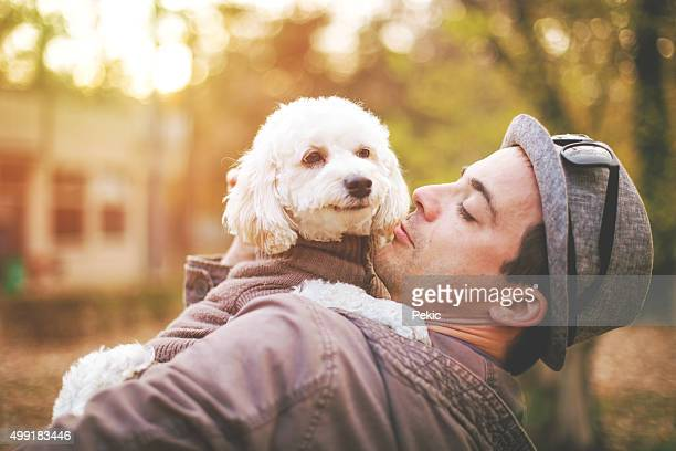 Cute little bichon enjoy outdoor with her favorite person
