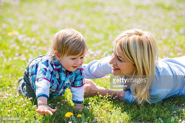 Cute little boy and his mother enjoying in nature.