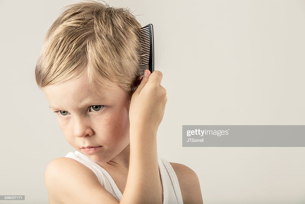 Cute Little Boy Combing His Hair Stock Photo Getty Images