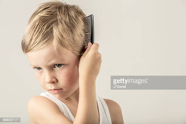 Child combing hair stock photos and pictures getty images cute little boy combing his hair urmus Choice Image