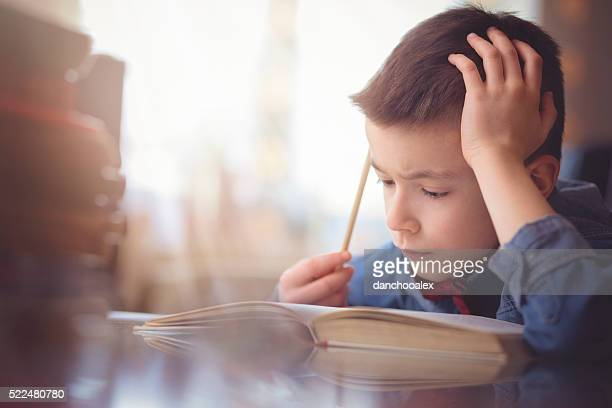 Cute little boy doing his homework
