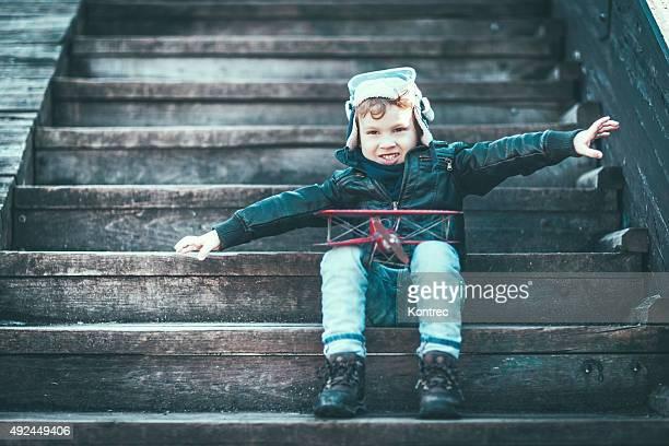 Cute little boy dreaming of becoming a pilot