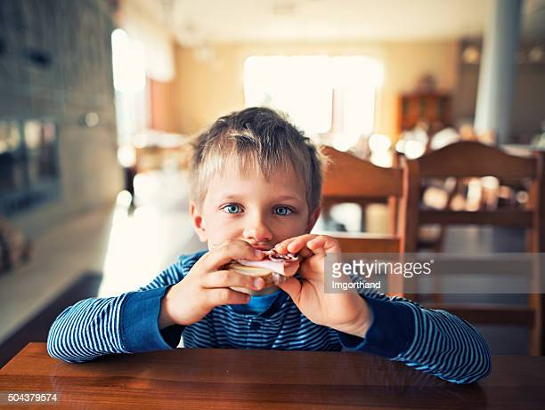 Cute little boy eating breakfast