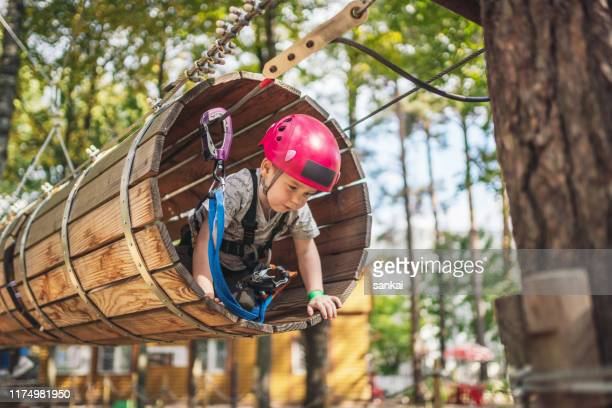 cute little boy in an adventure park - eco tourism stock pictures, royalty-free photos & images