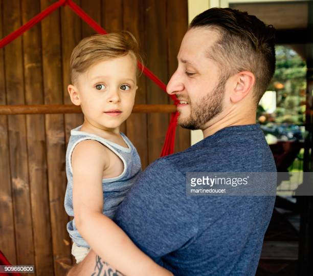 """cute little boy in father arms at summer house outdoors. - """"martine doucet"""" or martinedoucet stock pictures, royalty-free photos & images"""