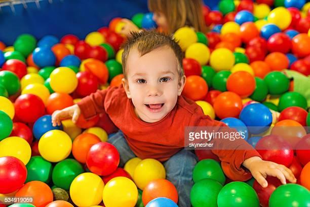 Cute little boy in playroom.