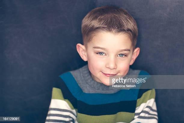 cute, little boy in striped sweater