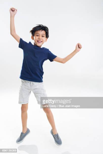 Cute little boy jumping
