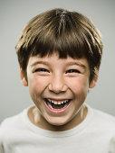Cute little boy laughing in studio