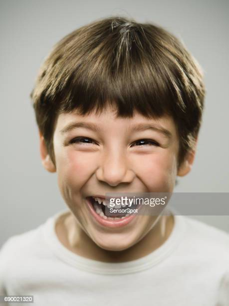 Cute little boy laughing in studio