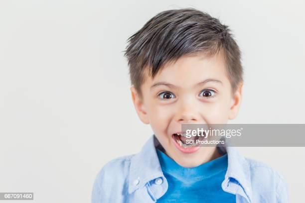 Cute little boy making a face