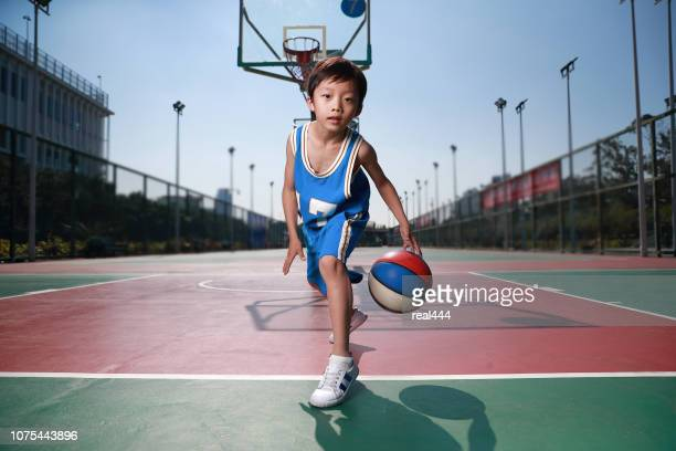 cute little boy playing basketball - one boy only stock pictures, royalty-free photos & images