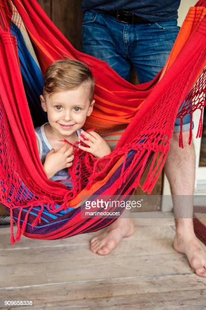 """cute little boy playing in hammock at summer house outdoors. - """"martine doucet"""" or martinedoucet stock pictures, royalty-free photos & images"""