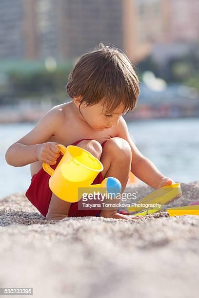 Cute little boy, playing on the beach