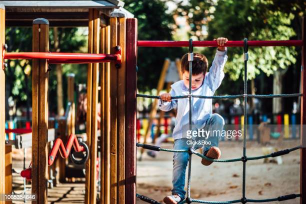 Cute little boy playing outdoors in a park