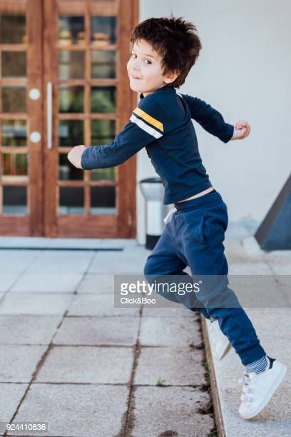 Cute little boy playing outdoors