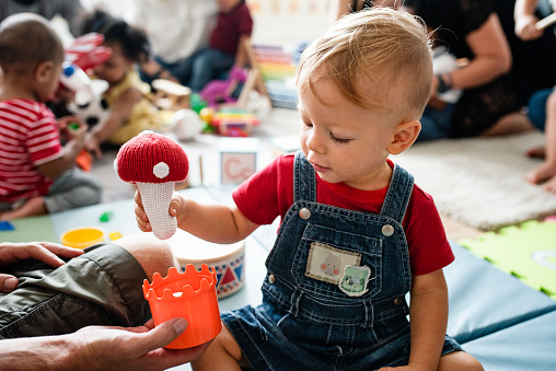 Cute little boy playing with toys at the learning center 1067729744