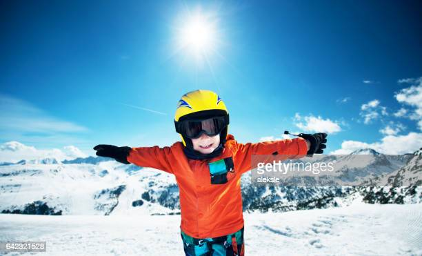 cute little boy posing on camera in andorra ski resort - andorra stock pictures, royalty-free photos & images