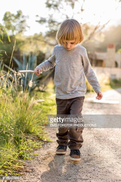 cute, little boy running on a street
