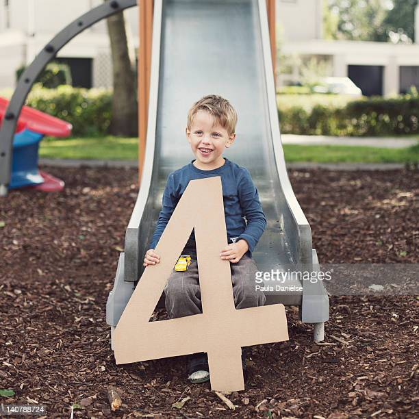 Cute little boy sitting on slide