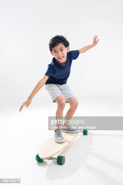 Cute little boy skateboarding