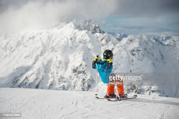 cute little boy, skiing happily in austrian ski resort ischgl silvretta arena - dezember stock-fotos und bilder