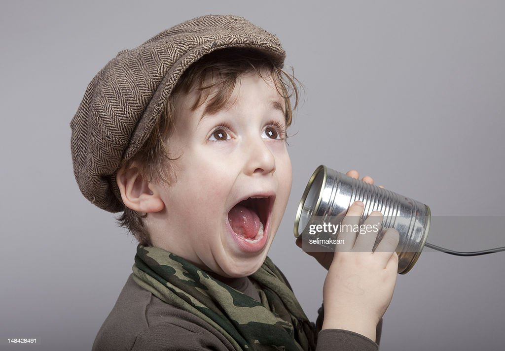 Cute Little Boy Surprised While Communicating On Tin Can Phone : Stock Photo