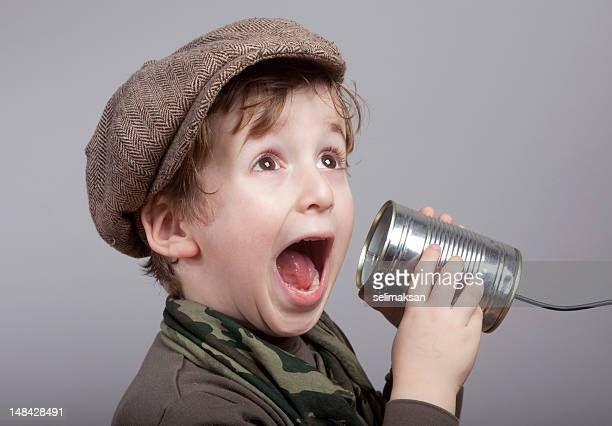 Cute Little Boy Surprised While Communicating On Tin Can Phone