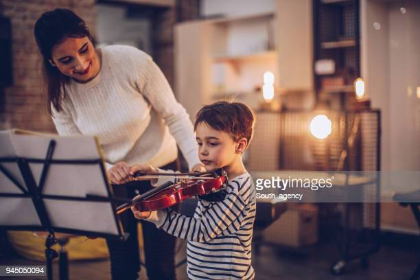 cute little boy teaching to play violin - rehearsal stock pictures, royalty-free photos & images