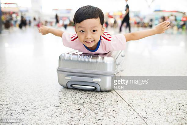 Cute little boy waiting in the airport, child travel