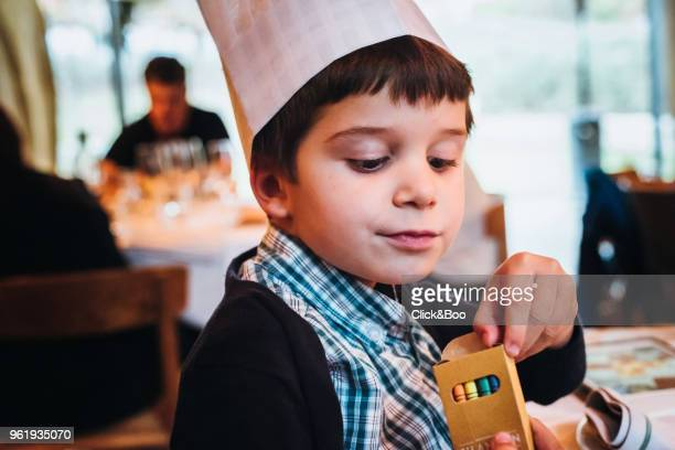 Cute little boy with a chef hat