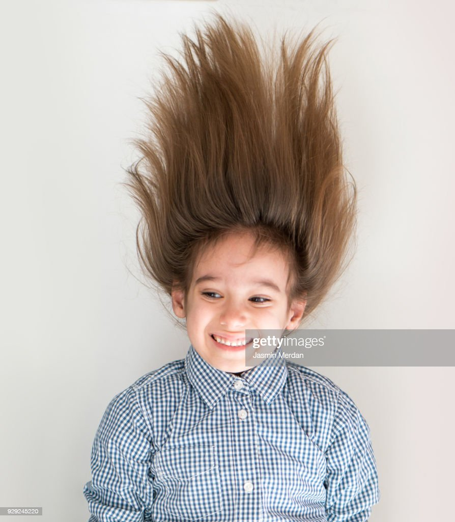 Cute Little Boy With Long Hair Upside Down High Res Stock Photo Getty Images