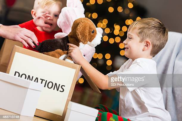 Cute little boys choosing toys to donate for Christmas