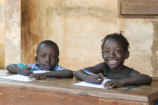 Cute Little Children Learning with Pens Paper in Mali, Africa 535986611