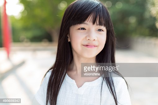 Cute Little Chinese Girl High-Res Stock Photo - Getty Images