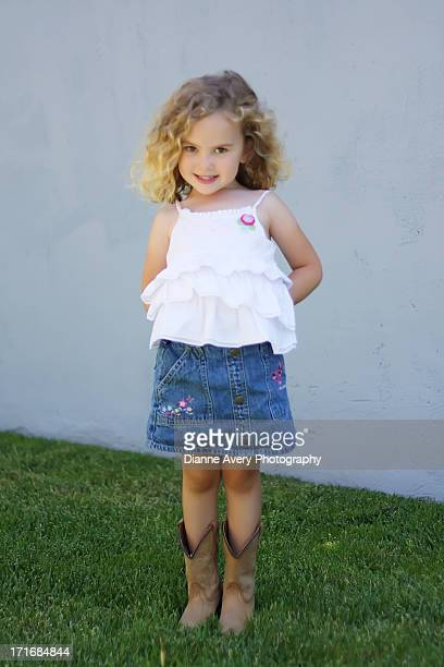 Cute little curly haired cowgirl