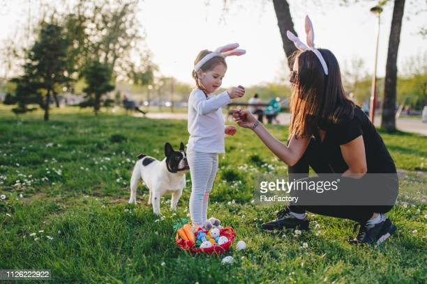 cute little four year old playing with colorful easter eggs - happy easter mom stock pictures, royalty-free photos & images