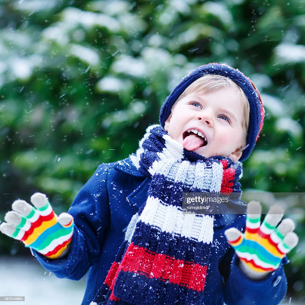 Cute little funny boy in colorful winter clothes with snow   Stock Photo 59e94cd7c