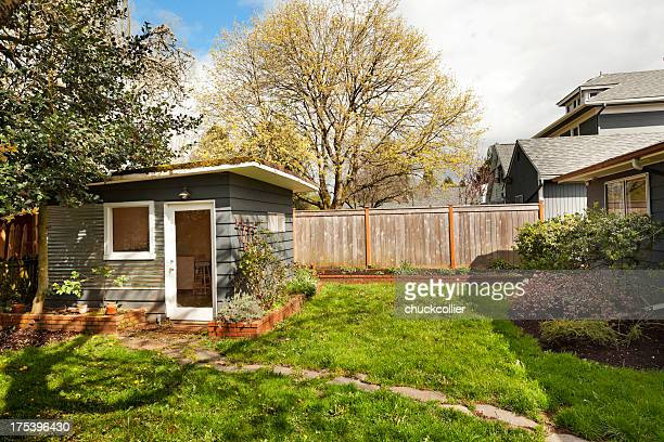 cute little garden shed in back yard - shed stock pictures, royalty-free photos & images