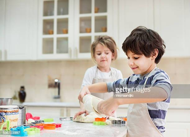 Cute little girl and boy baking together